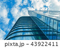 modern business high rise glass building and blue sky with clouds 43922411