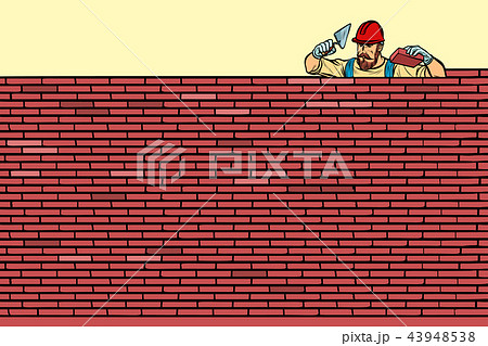 The Builder lays brick masonry at the top 43948538