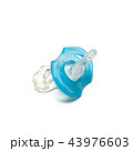 Blue pacifier for baby on white background 43976603