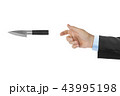 Hand is throwing a knife 43995198