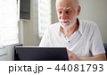 Handsome elderly senior man working on laptop computer at home. Remote freelance work on retirement 44081793