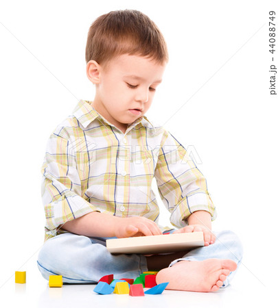 Little boy is playing with toys 44088749