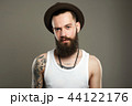 Handsome Bearded Man in Hat. boy with tattoo 44122176