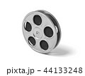3d rendering of a single movie reel with steel casing on a white background. 44133248