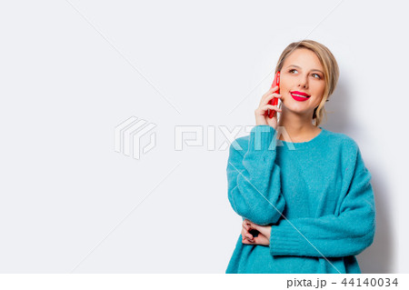 woman with mobile phone on white background 44140034