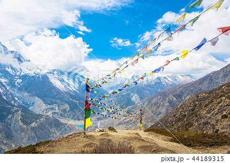 Rows of colored flags over the Himalayas, Nepal.  44189315