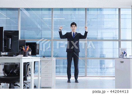 A day of young businessman in the office 030 44204413