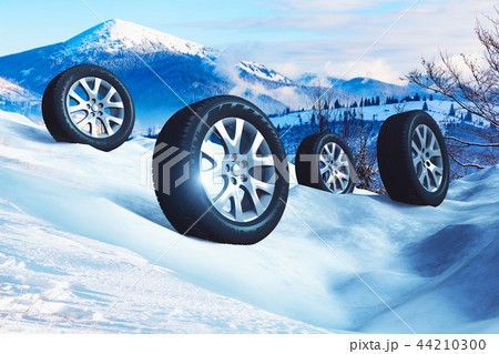 Car wheels with offroad winter tyres on snow 44210300