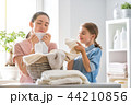 family doing laundry at home 44210856