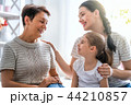 girl, her mother and grandmother 44210857
