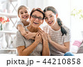 girl, her mother and grandmother 44210858
