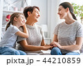 girl, her mother and grandmother 44210859