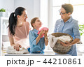 family doing laundry at home 44210861