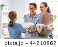 family doing laundry at home 44210862