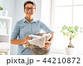 woman doing laundry at home 44210872