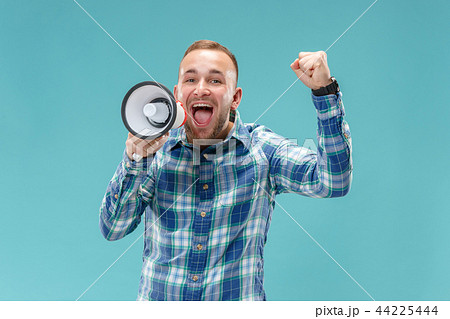 man making announcement with megaphone 44225444