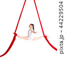 Woman hanging in aerial silks, isolated on white 44229504