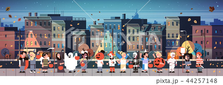kids wearing monsters costumes walking night town holiday concept cityscape background tricks or 44257148