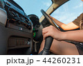 Hand of woman touching gear transmission of SUV 44260231