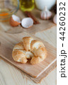 Croissant on wooden cut board on table wood  44260232