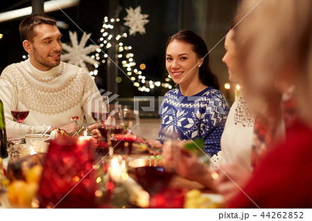 happy friends having christmas dinner at home 44262852
