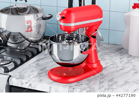Red stand kitchen mixer on the kitchen table 44277190