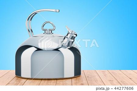 Big metallic kettle on the wooden table 44277606