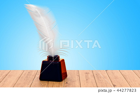Feather and ink bottle on the wooden table 44277823