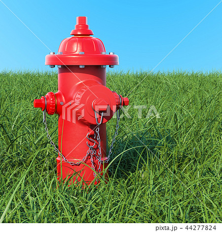 Fire hydrant in the green grass against blue sky 44277824