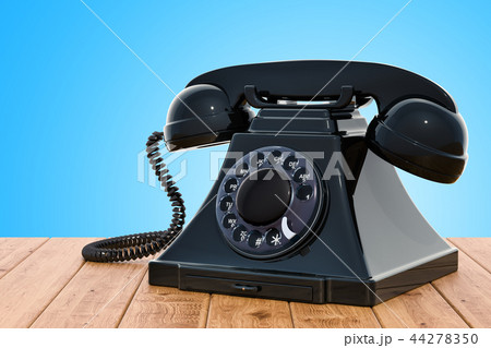 Retro telephone on the wooden table 44278350