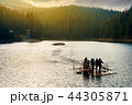 young tourists on a raft in the middle of a lake 44305871