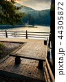 wooden bench on the pier of a Synevyr lake 44305872