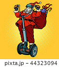 Santa Claus in VR glasses, with Christmas gifts rides an electri 44323094