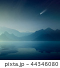 omet and stars in sky, silhouettes of mountains 44346080