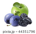 Fresh and dry plums with green apple isolated  44351796