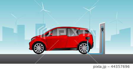 Red electric car with charging station. 44357696