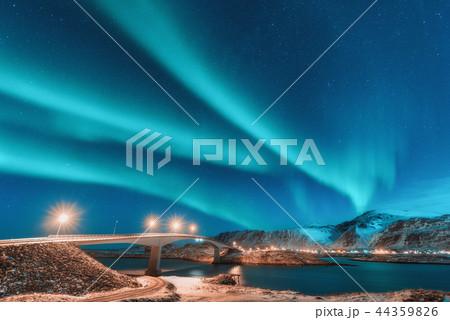 Northern lights above bridge with illumination  44359826