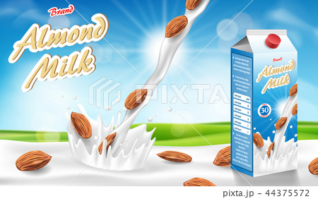 Almond milk glass with splash isolated on bokeh background with seeds. Milk products package design 44375572