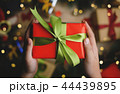 Hand Holding Red Green Christmas Gift 44439895