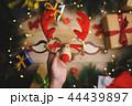 Hand Holding Christmas Reindeer Glasses 44439897