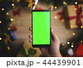 Hand Holding Green Screen Smartphone Christmas 44439901