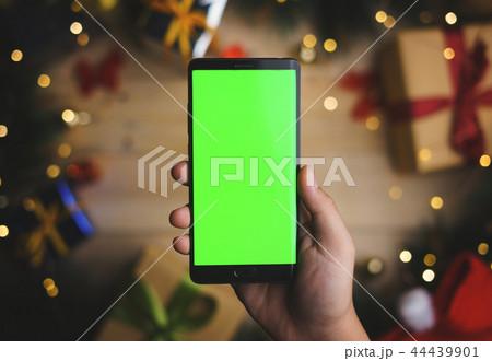 Hand Holding Green Screen Smartphone Christmas 44439901