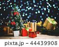 Small Christmas Tree Between Christmas Presents 44439908