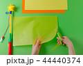 child's hands cut circle on transparent paper 44440374