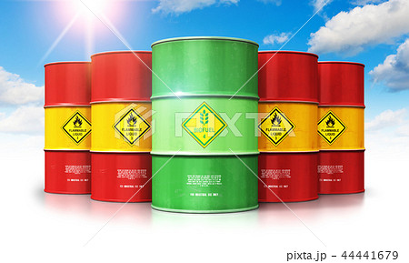 Green biofuel drum in front of red oil gas barrels 44441679