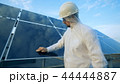 Male engineer cleans solar panel. 44444887