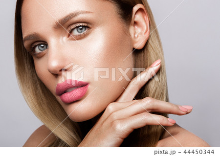 Beautiful young model with pink lips. Nude manicure 44450344