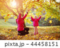 Mother playing with daughter on sunny day in autumn 44458151