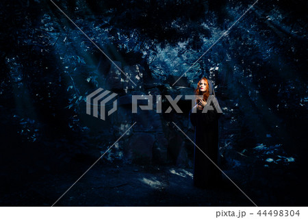 witch in night forestの写真素材 44498304 pixta