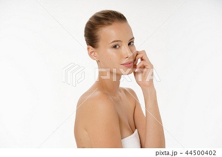 Beautiful young woman with clean fresh perfect skin. Portrait of model with natural nude make up 44500402